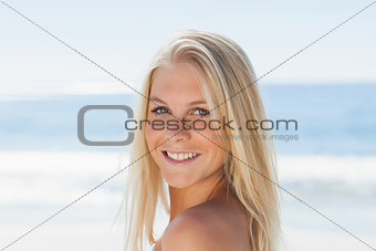 Close up view of blond woman smiling at camera