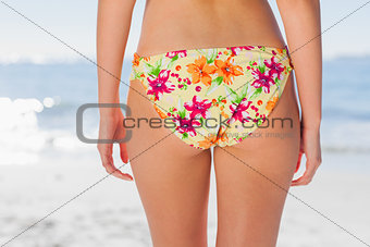 Woman in floral bikini on beach