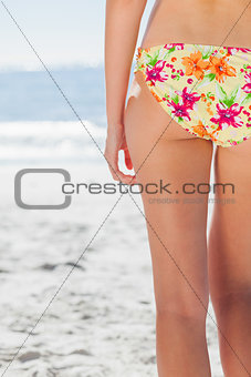 Woman in floral bikini standing back to camera