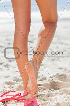 Womans legs on beach