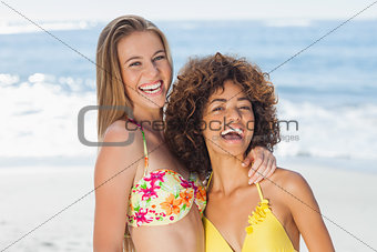 Two smiling friends posing together