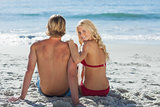 Rear view of couple on beach