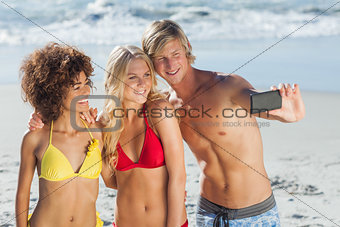 Three friends posing for a photo