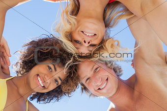 Low angle view of attractive friends on beach