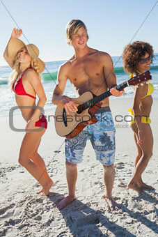 Friends dancing on the beach