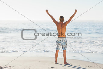Man cheering looking out to the sea