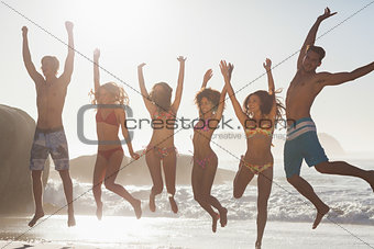 Laughing friends jumping