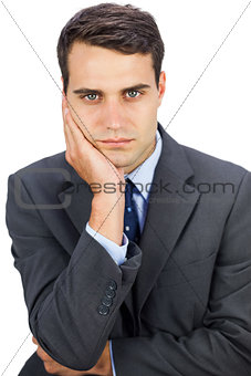Concentrated businessman looking at camera