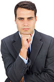 Frowning businessman looking at camera
