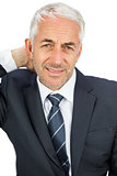 Businessman looking at camera touching his painful neck