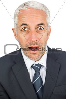 Shocked businessman looking at camera