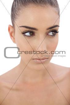 Unsmiling woman looking away