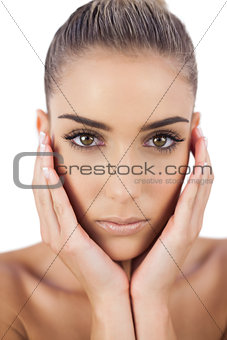 Beautiful woman holding her head and looking at camera