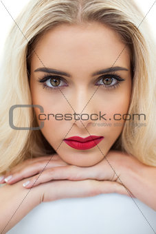 Close up of a serious blonde model looking at camera