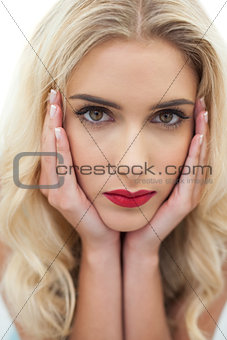 Close up of a stern blonde model looking at camera