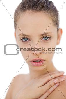 Contemplative brunette model looking at camera