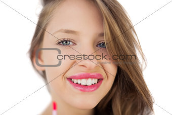 Happy brunette girl holding a gloss tube