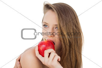 Attractive brunette model eating an apple