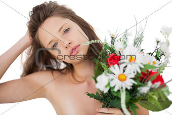 Attractive brunette model holding a bouquet of flowers