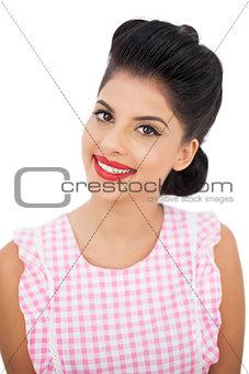 Smiling black hair model looking at camera