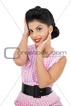 Delighted black hair model looking at camera