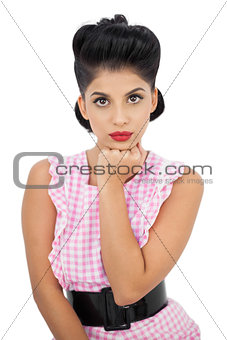 Concentrated black hair model looking at camera