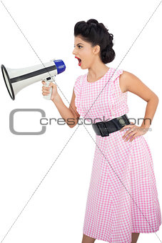 Angry black hair model shouting in a megaphone