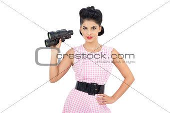 Pleased black hair model holding binoculars