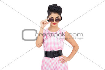 Pretty black hair model looking over her sunglasses