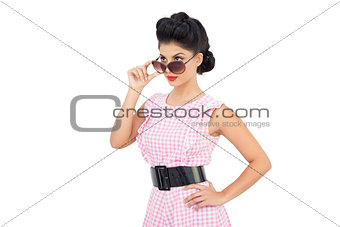 Charming black hair model looking over her sunglasses