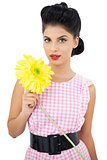 Gorgeous black hair model holding a flower