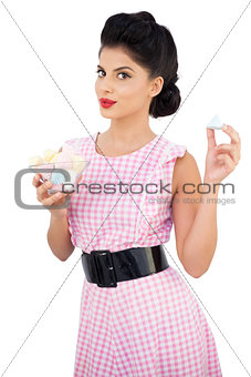 Content black hair model holding candies