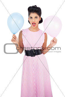 Amused black hair model holding balloons