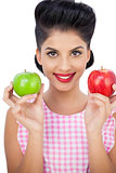 Happy black hair woman holding apples