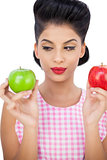 Thoughtful black hair model holding apples