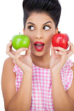 Surprised black hair model holding apples