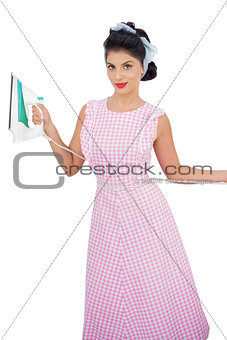 Attractive black hair model posing and holding an iron