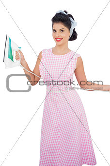 Smiling black hair model posing and holding an iron