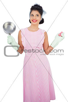 Cheerful black hair model holding a pan and wearing rubber gloves