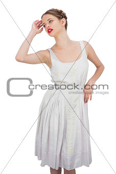 Attractive model in white dress posing