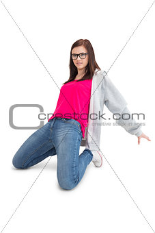 Smiling young woman making hip hop pose
