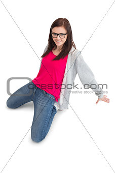 Cheerful young woman making hip hop pose