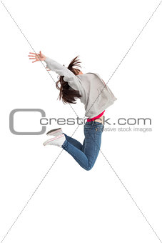 Cheerful young woman jumping