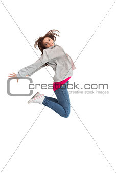 Pretty young woman jumping