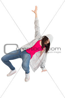 Casual young woman making hip hop pose