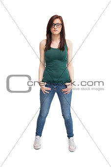Casual young woman with glasses posing