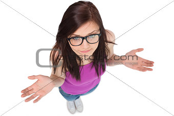 High angle view of uncertain brunette with glasses posing