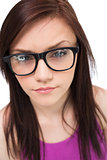 Close up on pretty brunette with glasses posing