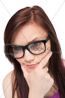 Close up on thoughtful brunette with glasses posing