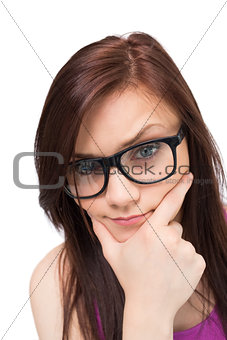 Close up on thinking brunette with glasses